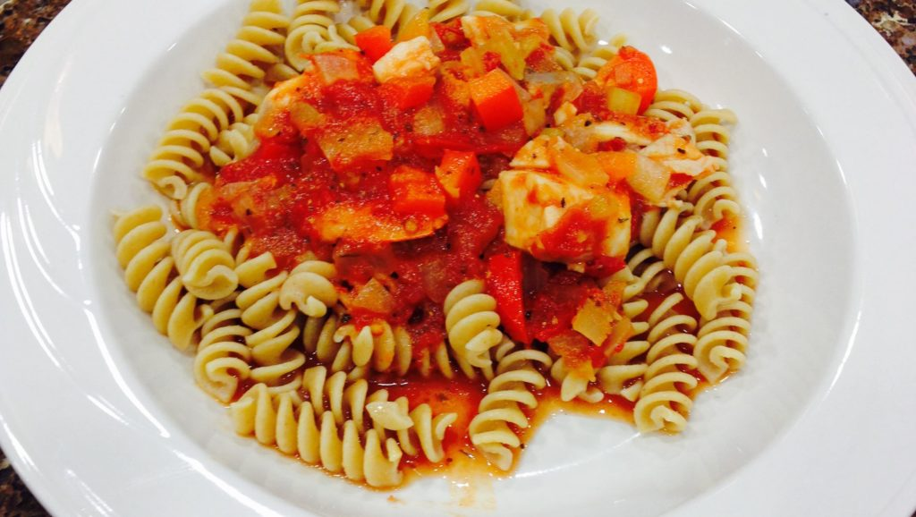 Whole wheat pasta with tomatoes and chicken